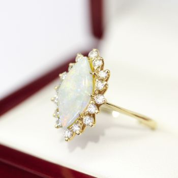 Great Vintage Opal and Diamond Cocktail ring, Cluster ring.  Marquise shape opal with orange blue green flash.
