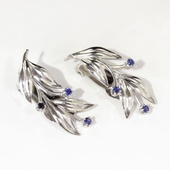 Vintage clip on leaf shaped white gold and sapphire earrings.  Very elegant.