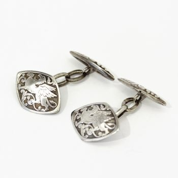 Vintage sterling silver cufflinks with ornate dragon and scroll design