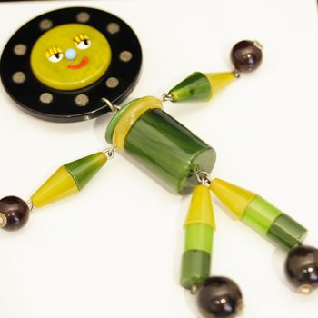 Fantastic Art Deco green and butterscotch Bakelite articulated novelty character brooch.