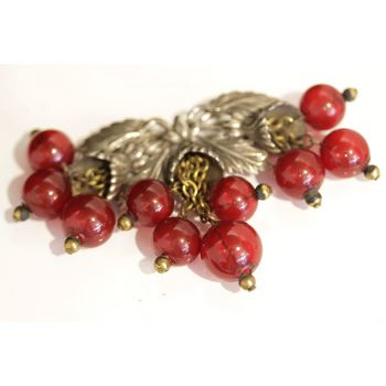 Art Nouveau brooch, in metal leaves design with bakelite cherries.  Novelty Bakelite brooch.