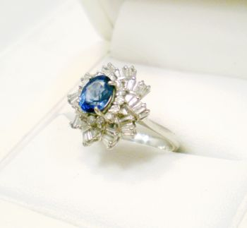 Antique Platinum and Diamond Cocktail ring featuring an oval Ceylon type Sapphire, Circa 1940s