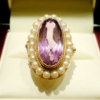 Victorian Amethyst and seed Pearl dress ring featuring an Oval Amethyst bezel set