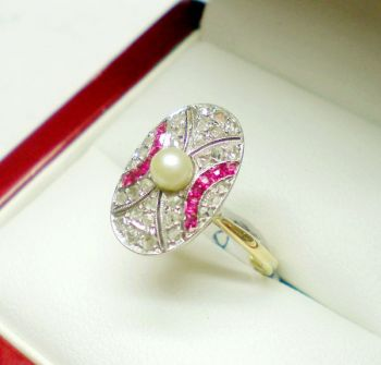 Pearl, Ruby and Diamond Deco ring in an oval shape featuring a Pearl centre with Ruby and Diamond curved accents