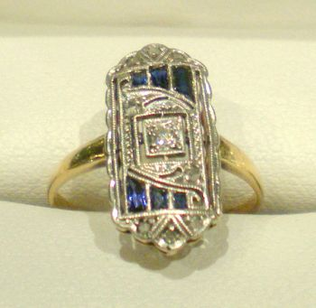 Antique Art Deco 18ct Gold and Platinum setting featuring 9 old rose cut Diamonds and Sapphires.