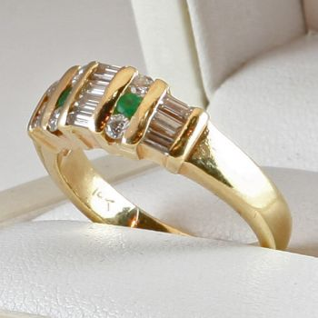 Emerald and Diamond ring featuring Baguette Diamonds and channel set Emeralds. Estate ring.