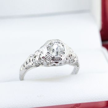 An Art Deco Diamond Ring in 18k White Gold featuring a stunning center Diamondweighing a total of approximately 0.55 carat.
