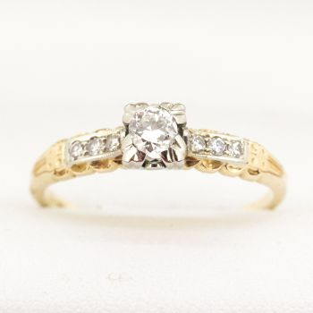 Vintage engagement ring with 7 early transitional cut Diamonds, G colour VS clarity