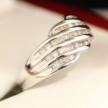 White gold and diamond wedding band ring, with 31 channel set diamonds.