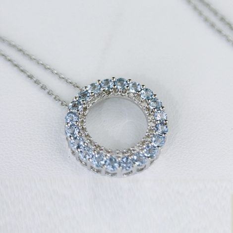 white gold Topaz and Diamond round pendant necklace