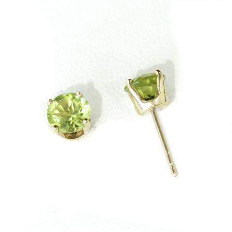 Vintage Peridot single stone stud earrings in 14k yellow gold prong set earring mounts