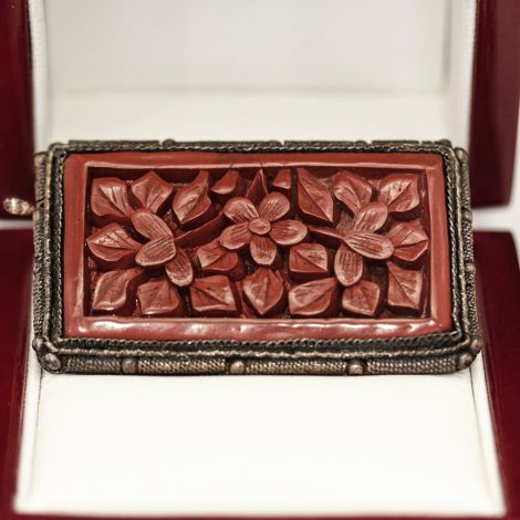 Antique silver and gold gilt brooch with bezel set carved Cinnabar insert