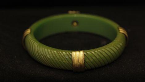 Art Deco era Bakelite Carved Bangle with gold metal detail.  Vintage Olive green Bakelite bangle.