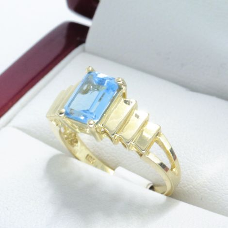 Emerald cut Blue Topaz with geometric stepped shoulders