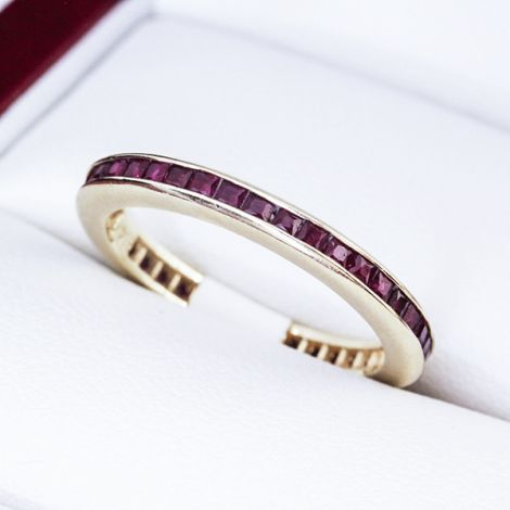 yellow gold and ruby eternity band channel set rubies