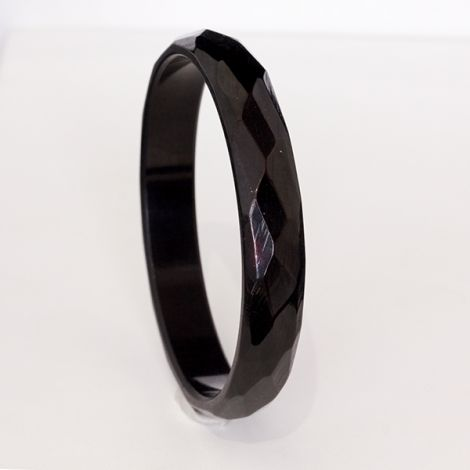Great vintage faceted Bakelite bangle in shiny black.
