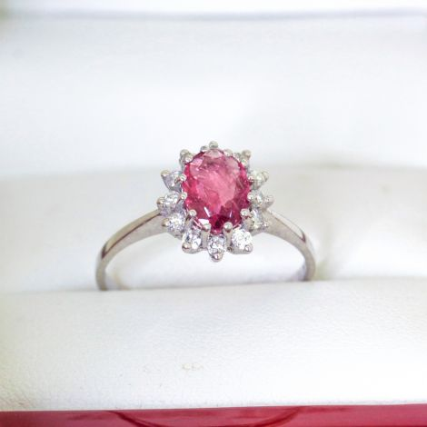 Natural Pink Sapphire Ring in White Gold with Diamonds in a Halo setting