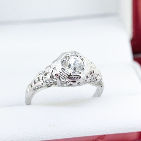 An Art Deco Diamond Ring in 18k White Gold featuring a stunning center Diamond weighing a total of approximately 0.55 carat.